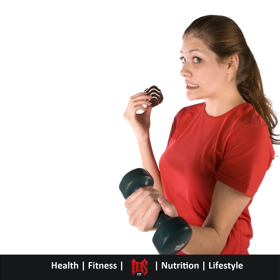 Girl having 'just one' piece of cake while working out to make it ok
